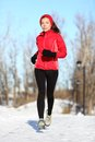 Sport woman running in winter Stock Photography