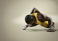 Sport. Young athletic man doing push-ups