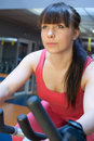 Sport young woman s portrait in gym Royalty Free Stock Image