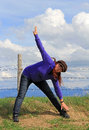 Sporting activity in nature a woman doing gymnastics and stretching exercises Stock Photography
