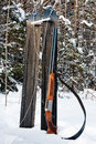Sporting gun and skis in the snow Stock Photo