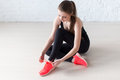 Sportive active girl lacing trainers sports shoes tie shoelaces Stock Photos