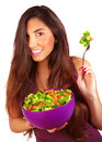 Sportive girl eating fresh salad vegetarian isolated on white background loss weight healthy nutrition body care and beauty Stock Image