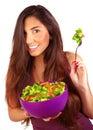 Sportive girl eating fresh salad Royalty Free Stock Photo