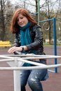 Sportive girl riding carousel Stock Image