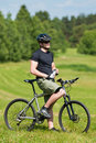 Sportive man mountain biking relax sunny meadows Royalty Free Stock Photo