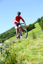 Sportive man riding bike in natural landscape mountain summertime Royalty Free Stock Images