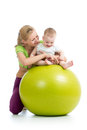 Sportive mother and baby having fun with on gymnastic ball Stock Photography