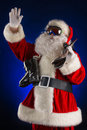 Sportive santa claus is standing in the ski mask and holding a skiing christmas Stock Photography