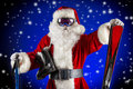 Sportive santa claus is standing in the ski mask and holding a skiing christmas Royalty Free Stock Photos