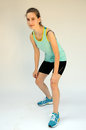 Sportive teeny photo of sporty teenager girl in sportswear Stock Image
