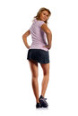 Sportive woman looking back rear view of a young over shoulder attractive girl with long and beautiful legs is watching behind her Stock Images