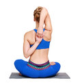Sportive woman making yoga asana gomukhasana Royalty Free Stock Photo