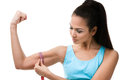 Sportive woman measures her bicep Stock Image