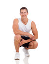 Sportive young man posing isolated on white Stock Photo