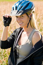 Sportive young woman bike helmet sunny outdoor Royalty Free Stock Image