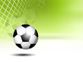 Sports background soccer ball in net against green Royalty Free Stock Photos