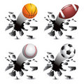 Sports balls breaking through glass Royalty Free Stock Images