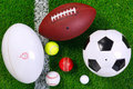 Sports balls on grass from above. Royalty Free Stock Photo