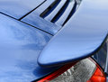 Sports car with airfoil closeup of blue Royalty Free Stock Photo