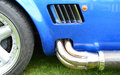Sports car exhaust pipe Royalty Free Stock Photo