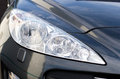 Sports car headlight grey Royalty Free Stock Photo