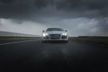 Sports car rushing up to you Royalty Free Stock Photos