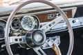 Sports car steering wheel classic cars on display during show Stock Image
