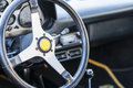 Sports car steering wheel classic cars on display during show Royalty Free Stock Image