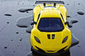 Sports car yellow isolated over water drops background Royalty Free Stock Photo