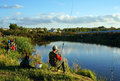 Sports competitions on fishing on catching of a carp and a sturgeon fishermen on lake kostroma russia at september with Royalty Free Stock Images