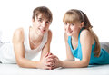 Sports couple is lying in the studio Royalty Free Stock Image