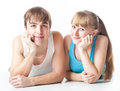 Sports couple is lying in the studio Stock Photos