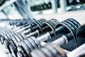 Sports dumbbells in modern club weight training equipment Stock Image