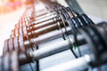 Sports dumbbells in modern club weight training equipment Royalty Free Stock Photos