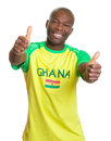 Sports fan from ghana showing both thumbs football on an isolated white background up Stock Images