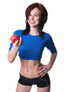 Sports girl with apple pretty slim and fit young sporty brawny woman model wearing blue top showing her torso black shorts resting Royalty Free Stock Photos