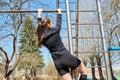Sports girl on the crossbar