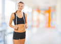 A sports girl with measure tape sportsgirl in clothes in the gim Royalty Free Stock Photos