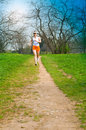 Sports girl runs in park Stock Image