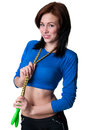 Sports girl with skipping rope attractive young woman holding a over her shoulders looking at camera and smiling toothy shy smile Stock Photos