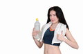 The sports girl with a towel and mineral water sportswoman on white background Royalty Free Stock Images