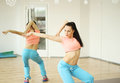 Sports girl in training in the pants and top skinny figure a good belly Stock Images
