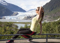 Sports girl the in wear posing with a view to mendenhall glacier juneau alaska Royalty Free Stock Images
