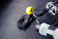 Sports gloves, sneakers, bottle with water and green apple Royalty Free Stock Photo