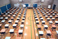 Sports hall set up for exams a huge with tables and chairs ready Royalty Free Stock Photo