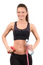 Sports and hydration beautiful fit girl holding dumbbells a bottle of water wrapped with a centimeter isolated on white Royalty Free Stock Photo