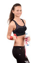 Sports and hydration beautiful fit girl holding dumbbells a bottle of water wrapped with a centimeter isolated on white Stock Photo