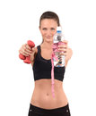 Sports and hydration beautiful fit girl holding in front dumbbells a bottle of water wrapped with a centimeter blur on the model Stock Photos