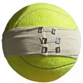 Sports injuries injury concept isolated tennis ball with elastic bandages with clip closures on white Royalty Free Stock Photos